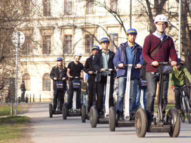 Group of men on Segway in Prague