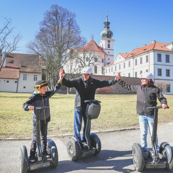 Family on segway infront of Brevnov Monastery in Prague