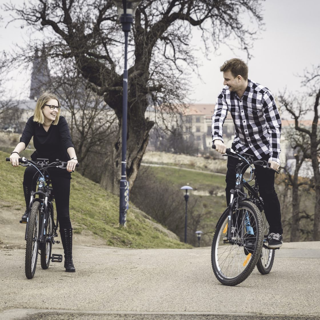Couple on Petrin hill in Prague on electric bikes